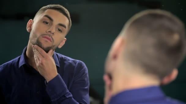 A man looks at his beard cut barbershop