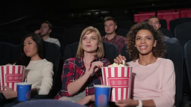 Young people are closely watching a movie