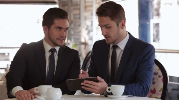 Men use the tablet at lunchtime