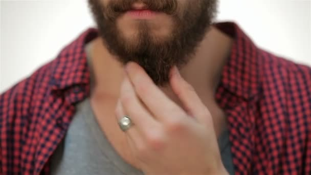 Closer portrait of man touching his perfect beard