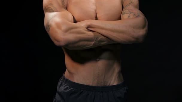 Close up man showing his muscular torso