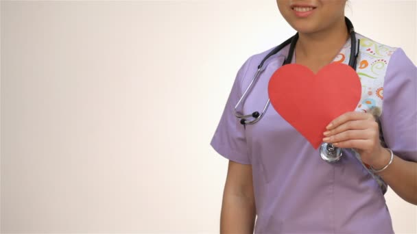 Asian girl nurses holding a paper heart