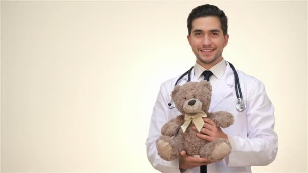 Childrens doctor is holding a teddy bear