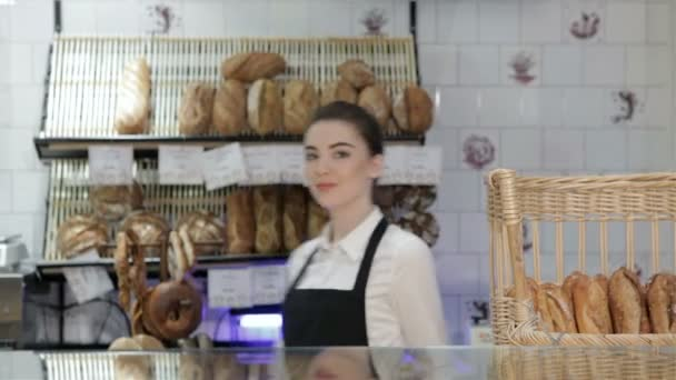 Woman baker smiling new buyer