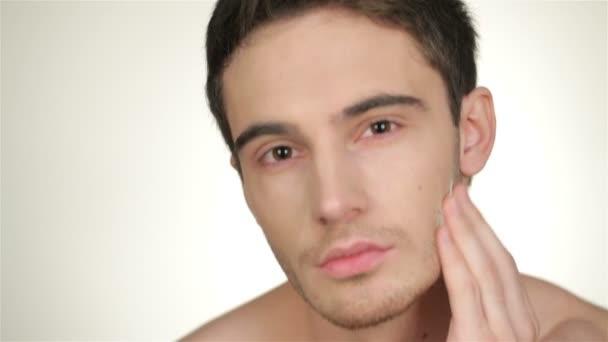 Male inflicts shaving foam