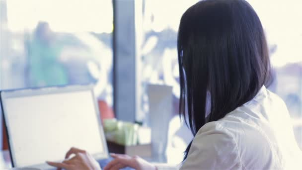 Business woman in a cafe with a laptop