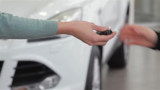 Saleswoman giving car key