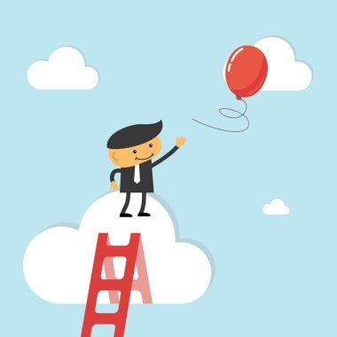 Businessman reach out for balloon