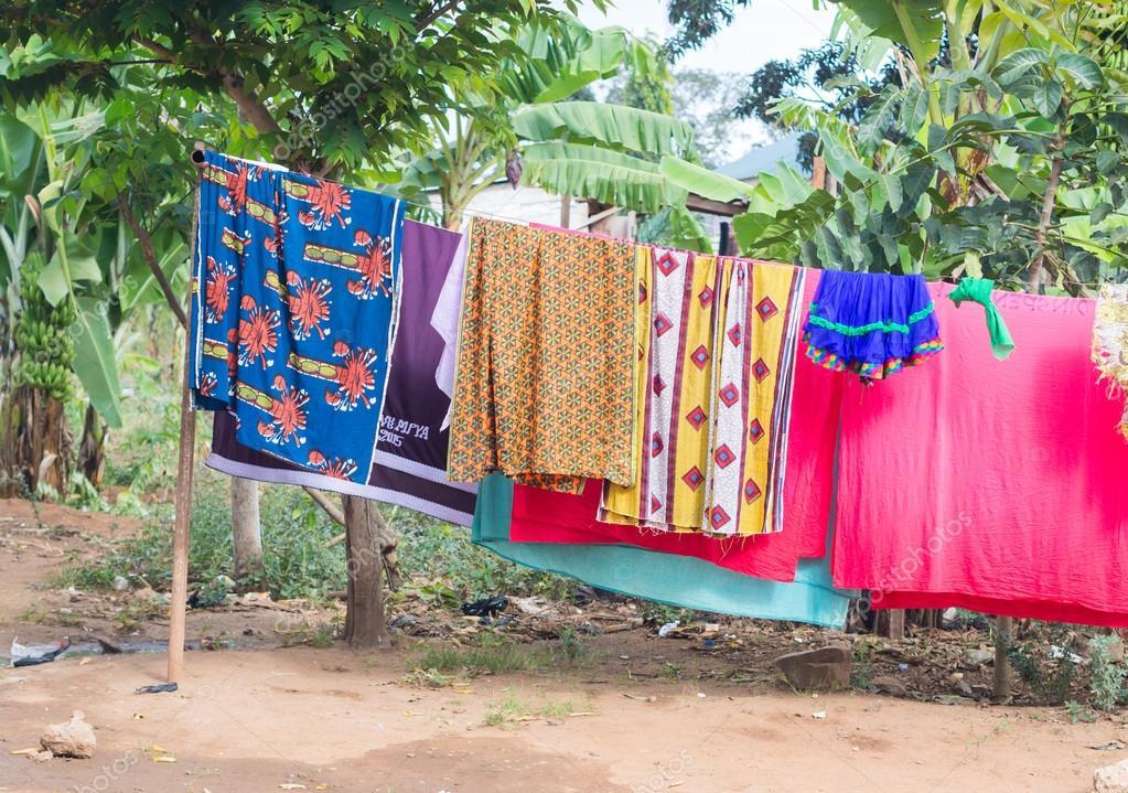 Colorful laundry including tanga and kitenge drying