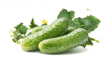 Cucumber group with leaves isolated on white