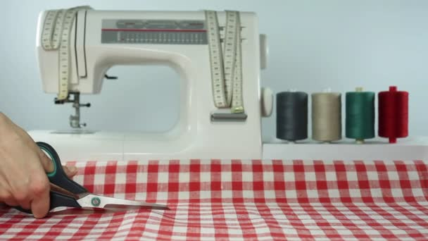 Tailor. Cutting fabric scissors. Dressmaker at work. Sewing.