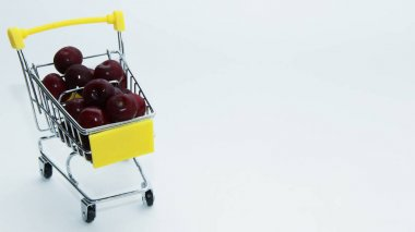 red cherries in a shopping cart