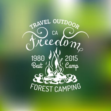 vintage camping logo on blurred background