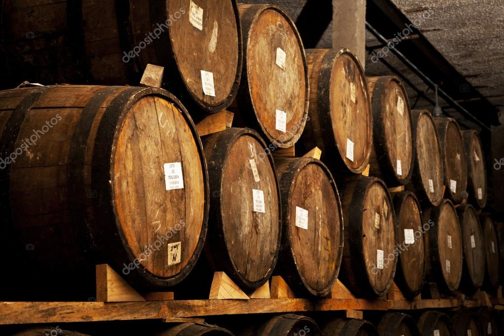 stacked oak barrels maturing red wine. Stacked Oak Barrels Maturing Red Wine. Contemporary Wine In The Old Cellar E