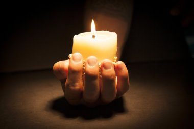 Hands with candle