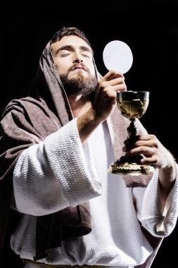 jesus praying and consecrating