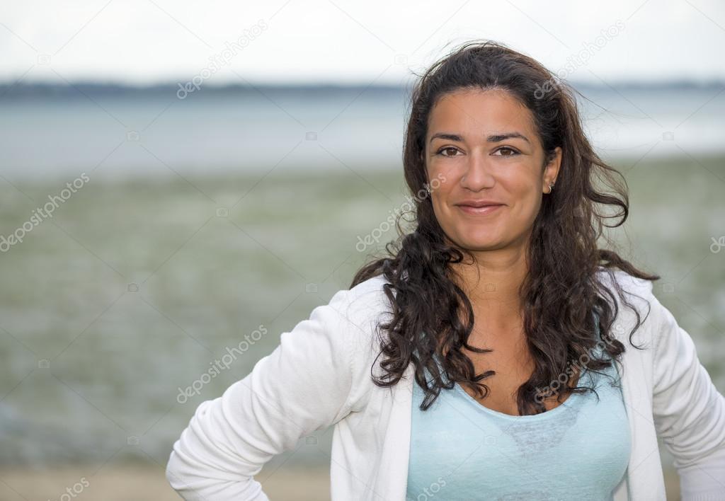 Young woman enjoy at the beach with copy space