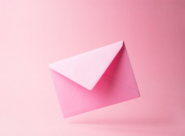 Pink envelope dropped over pink