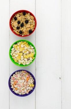 Three bowls of cereals