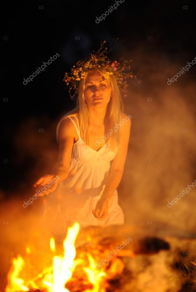 Ukrainian girl with a wreath of flowers on her head against a ba