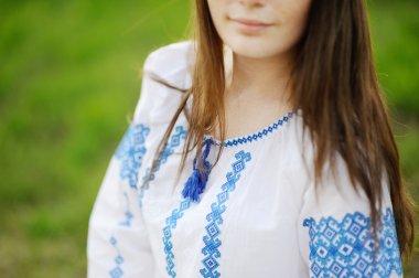 Girl dressed in Ukrainian national ornament