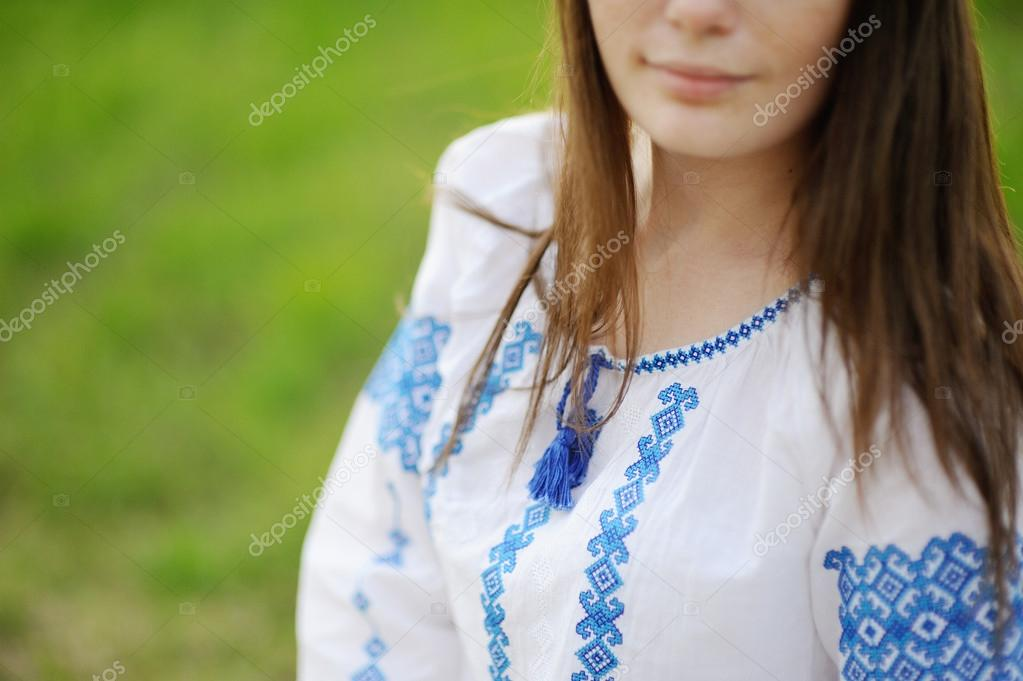 Girl dressed in Ukrainian national ornament