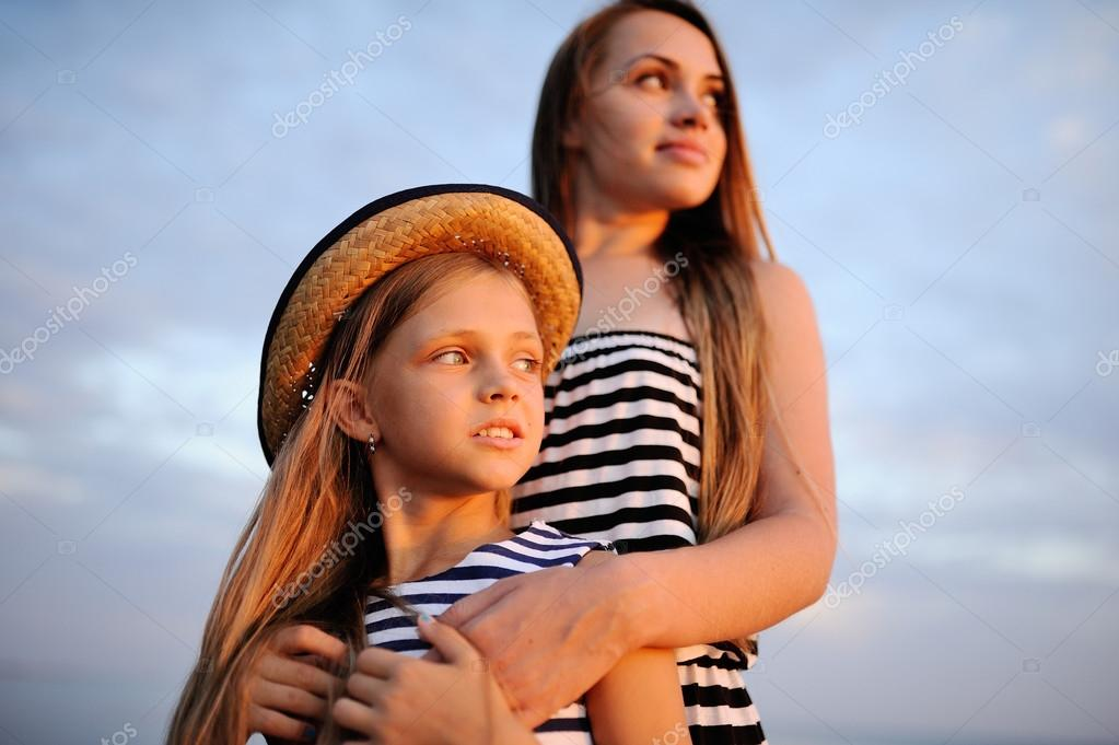eef4abc92ac two girls in striped dress at sunset — Stock Photo © Kalinovskiy ...