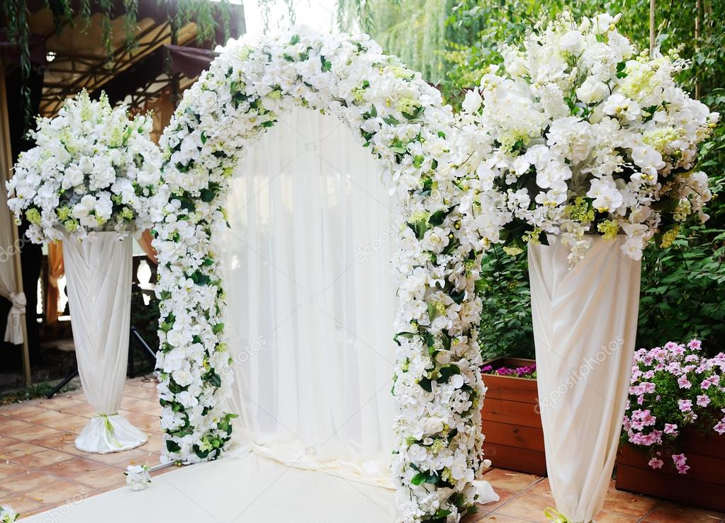 Wedding arch of white orchids and roses