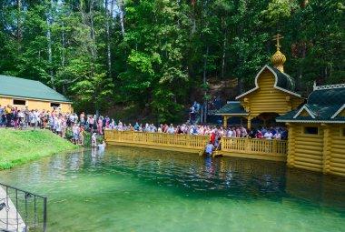 Pilgrims on holy source of St. Seraphim of Sarov, Russia