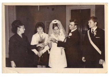 Solemn ceremony of marriage at registry office (vintage photo,1960)