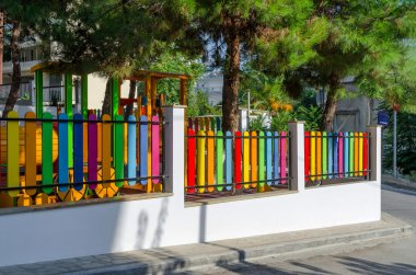 Greece, Halkidiki, bright multicolored fence on the street in Nea Kallikratia, Greece