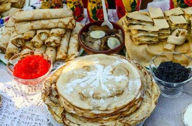 Pancakes with various fillings, with caviar, mushrooms