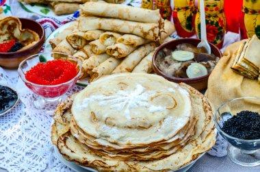 Pancakes with various fillings, caviar, mushrooms