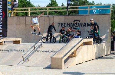 Skateboarder performs leap into ramp, Palanga, Lithuania