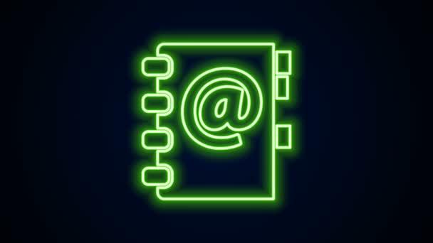Zářící neonový řádek Ikona Adresáře izolovaná na černém pozadí. Notebook, adresa, kontakt, adresář, telefon, ikona telefonního seznamu. Grafická animace pohybu videa 4K