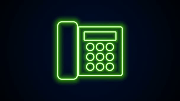 Ragyogó neon vonal Telefon ikon elszigetelt fekete háttérrel. Vezetékes telefon. 4K Videó mozgás grafikus animáció