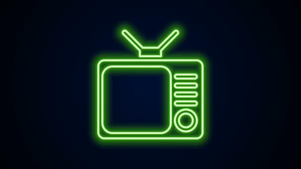 Ragyogó neon vonal Retro tv ikon elszigetelt fekete háttér. Televíziós jel. 4K Videó mozgás grafikus animáció