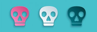 Paper cut Skull icon isolated on blue background. Paper art style. Vector. icon