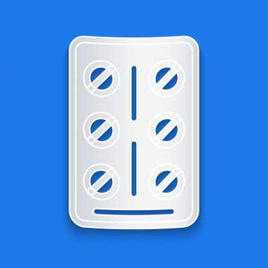 Paper cut Pills in blister pack icon isolated on blue background. Medical drug package for tablet, vitamin, antibiotic, aspirin. Paper art style. Vector. icon