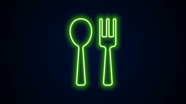 Zářící neonová čára Ikona vidlice a lžíce izolovaná na černém pozadí. Nádobí na vaření. Znamení příboru. Grafická animace pohybu videa 4K