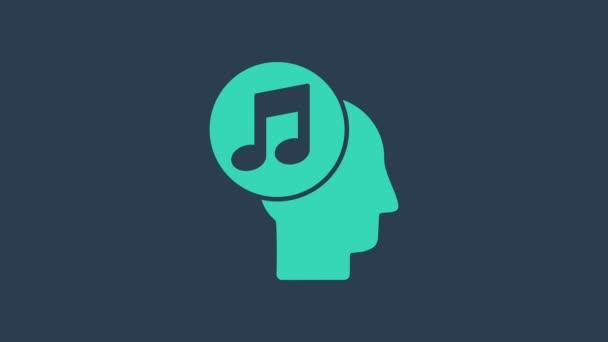 Türkiz Zenei megjegyzés az emberi fej ikon elszigetelt kék háttérrel. 4K Videó mozgás grafikus animáció