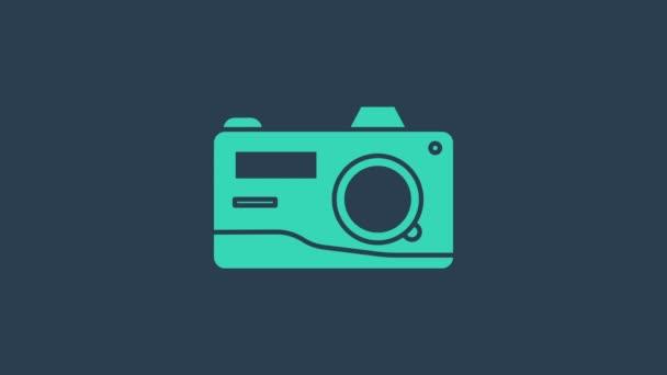 Tyrkysová ikona fotoaparátu izolované na modrém pozadí. Ikona fotoaparátu. Grafická animace pohybu videa 4K