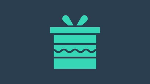 Türkiz Ajándék doboz ikon elszigetelt kék alapon. Boldog szülinapot! 4K Videó mozgás grafikus animáció