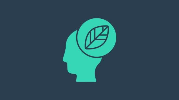 Türkiz Emberi fej levéllel az ikon belsejében, kék alapon elszigetelve. 4K Videó mozgás grafikus animáció