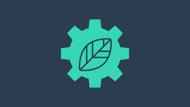Türkiz levél növény ökológia sebességváltó ikon elszigetelt kék alapon. Környezetbarát technológia. A környezetvédelmi világnap címkéje. 4K Videó mozgás grafikus animáció