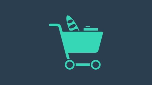 Tyrkysový nákupní košík a ikona potravin izolované na modrém pozadí. Obchod s potravinami, supermarket. Grafická animace pohybu videa 4K
