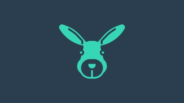 Türkisfarbenes Hasenkopf-Symbol isoliert auf blauem Hintergrund. 4K Video Motion Grafik Animation