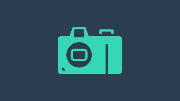 Türkis Fotokamera Symbol isoliert auf blauem Hintergrund. Ikone der Fotokamera. 4K Video Motion Grafik Animation