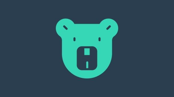 Tyrkysová ikona Medvědí hlavy izolovaná na modrém pozadí. Grafická animace pohybu videa 4K