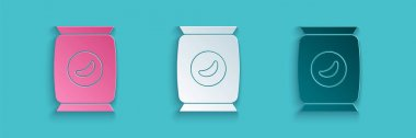 Paper cut Bag or packet potato chips icon isolated on blue background. Paper art style. Vector Illustration. icon